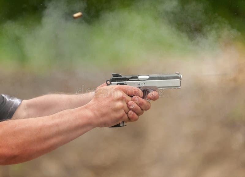 Prenda una pallottola fotografia stock
