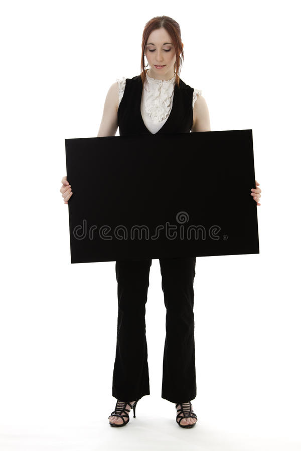 Prendendo uma placa fotografia de stock