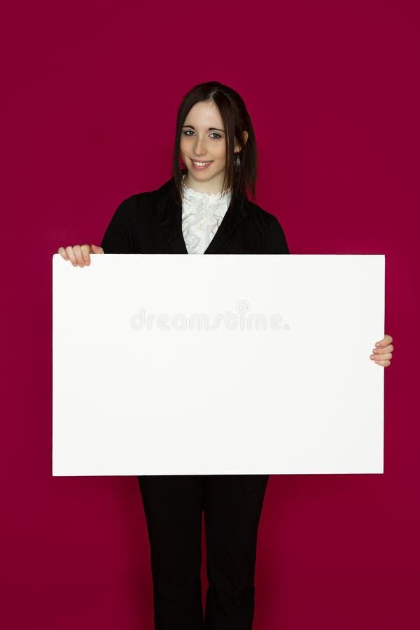 Prendendo uma placa fotos de stock