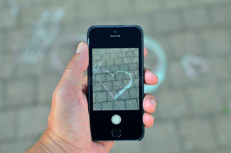 prendre des photos avec un smartphone image stock