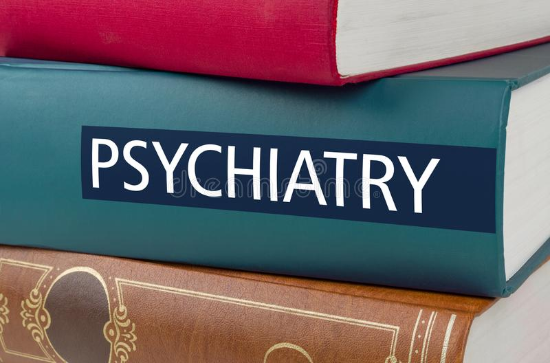 Prenoti con la psichiatria di titolo scritta sulla spina dorsale immagini stock libere da diritti