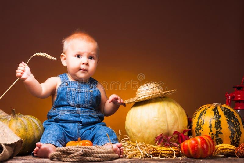Prentbriefkaar aan de dag van Dankzegging, leuke baby stock afbeelding