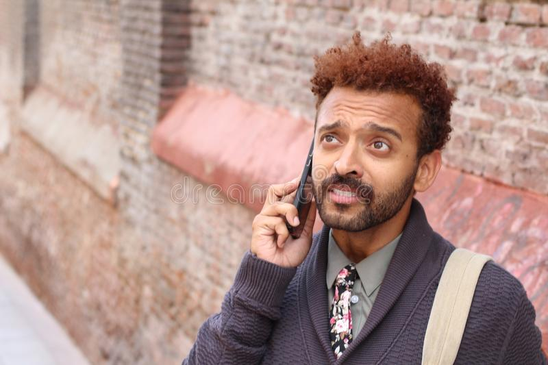 Preoccupied male during a crucial phone call stock photography