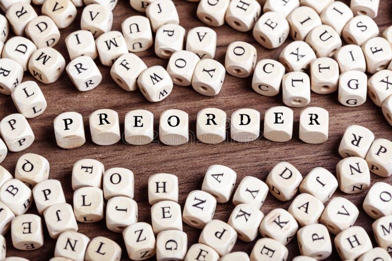 Preorder, letra corta palabra en cuadritos fotos de archivo libres de regalías