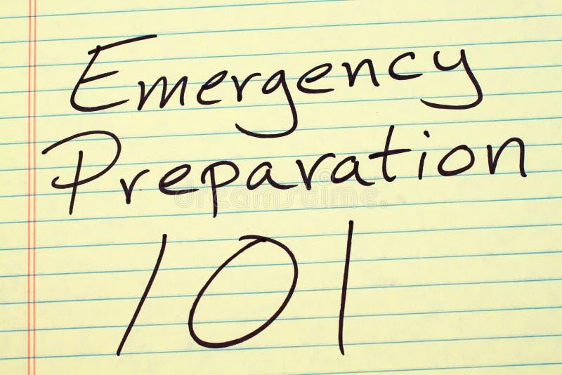 Preparação 101 da emergência em uma almofada legal amarela imagem de stock royalty free