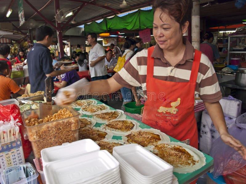 Preparação dos alimentos no mercado molhado chinês imagens de stock royalty free