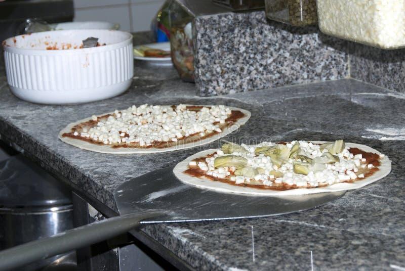 Preparación de la pizza imagen de archivo libre de regalías