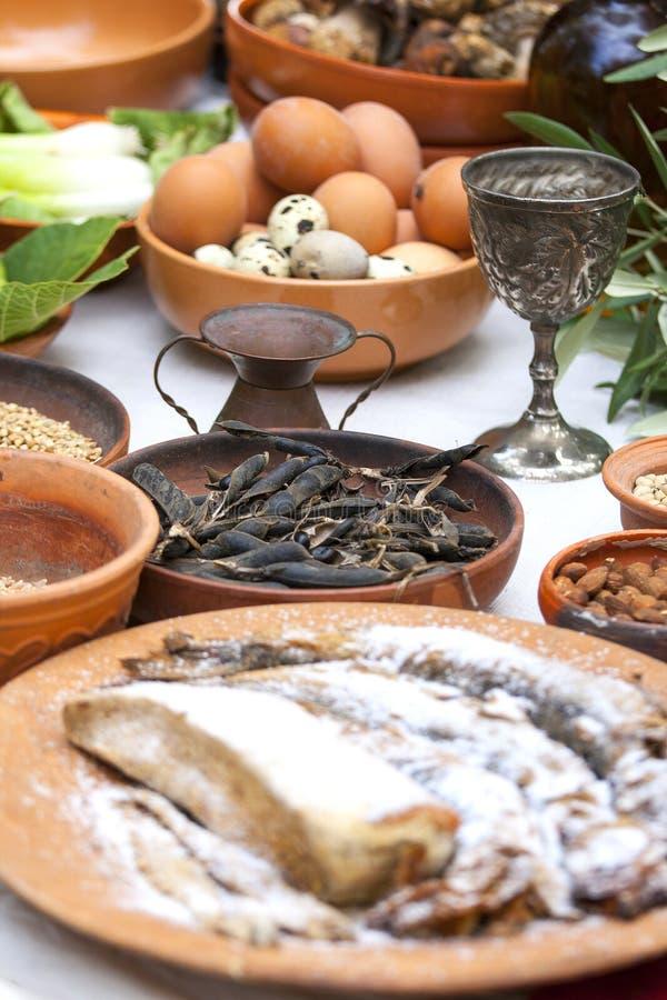 Preparando o alimento romano antigo fotografia de stock royalty free