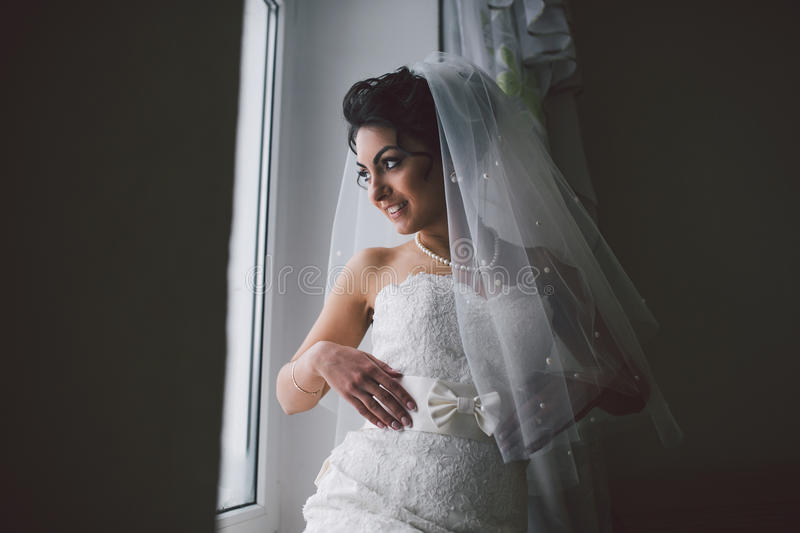 Preparation of adorable bride. royalty free stock photos