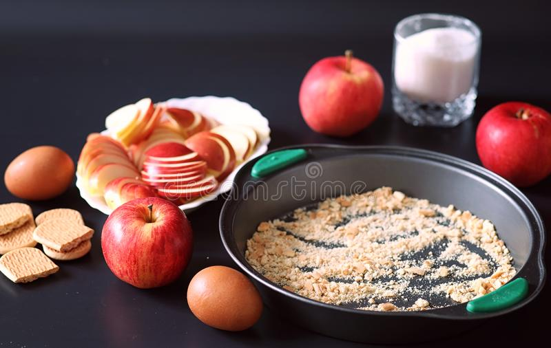 Preparation of apple pie at home. Homemade pastries with apples royalty free stock photo