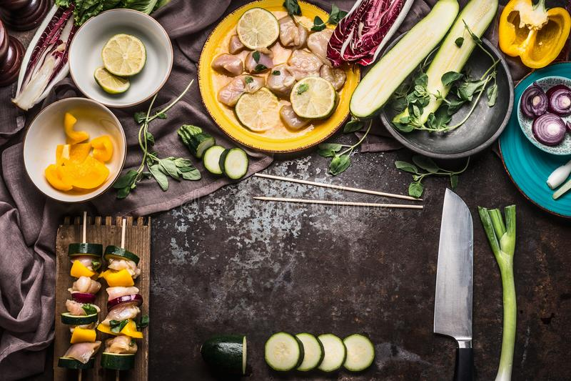 Preparation of Chicken homemade skewers with vegetables for grill on rustic background with fresh ingredients stock images