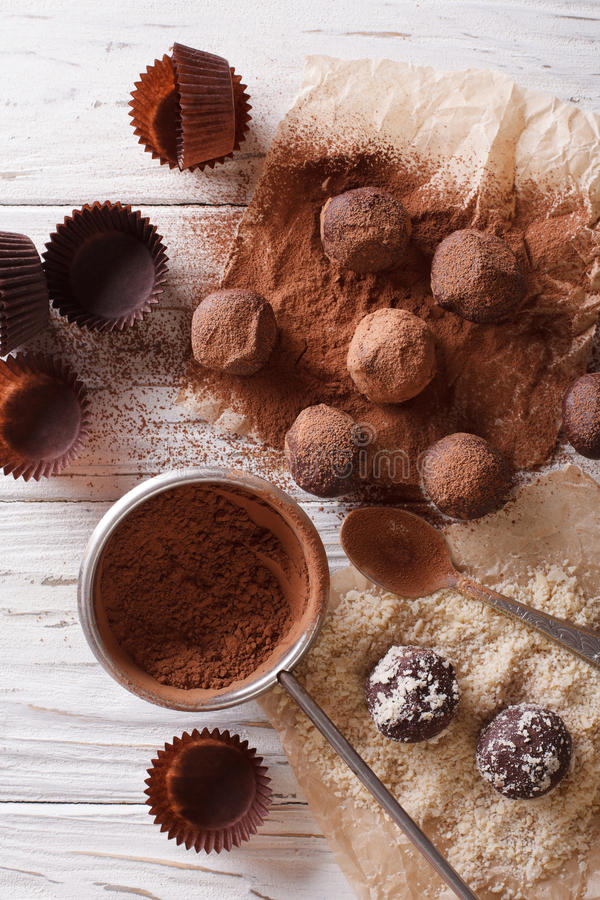 Preparation of chocolate truffles. vertical top view stock photos