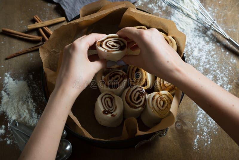 Preparation of cinnamon rolls stock image