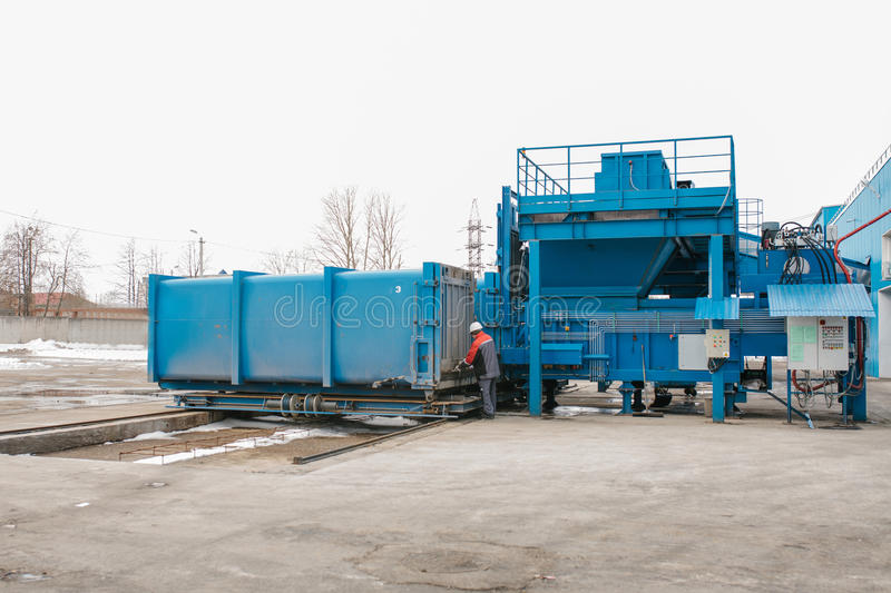 Preparation of a container with waste for subsequent transportation to a waste disposal plant. Waste processing plant royalty free stock photography