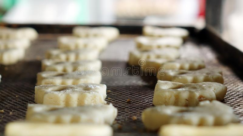 Preparation of cookies for baking. Cooking process in the kitchen.  royalty free stock photos