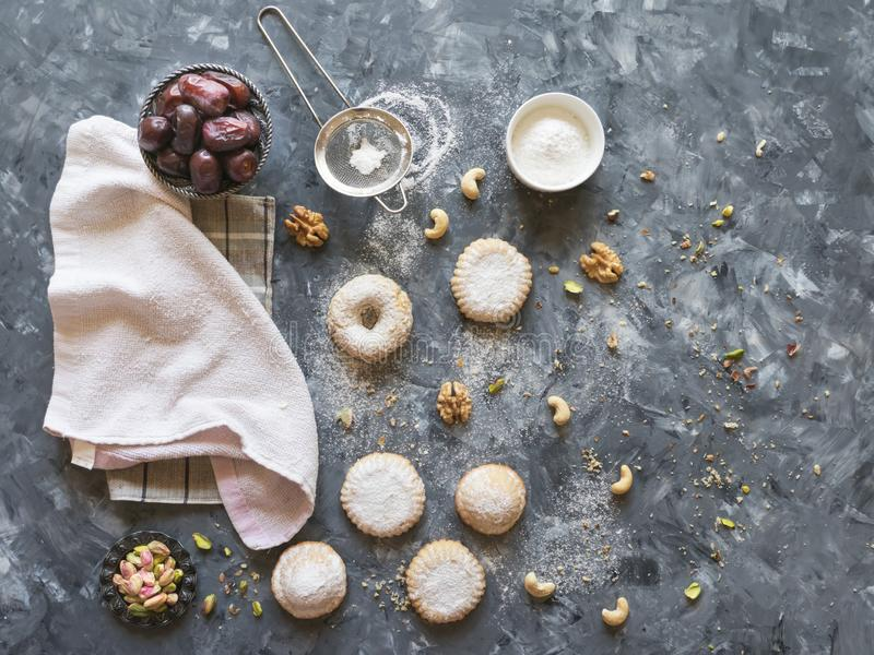 Preparation of cookies. Holidays food background. Arab sweets are laid out on a grey table.  stock photos