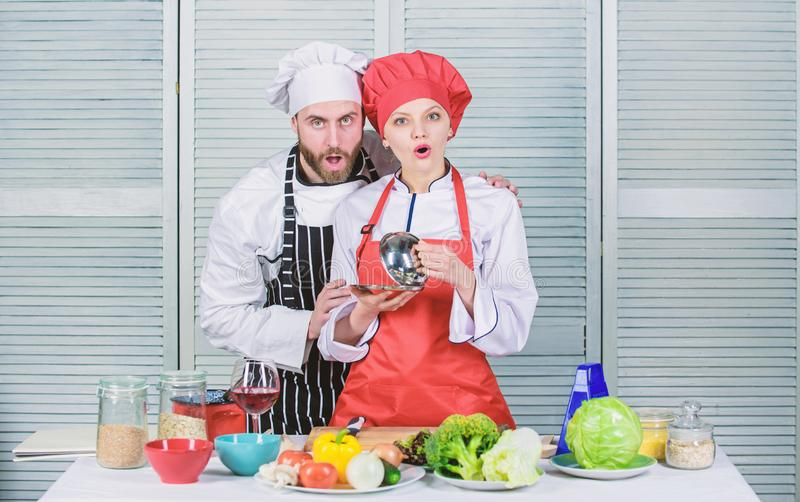 Preparation and culinary concept. happy couple in love with healthy food. man and woman chef in restaurant. Family royalty free stock image