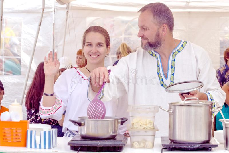 Preparation of dumplings at the Festival Glade for the participants to eat stock photography