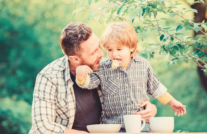 Preparation of food. healthy food and dieting. Happy family together. happy fathers day. Little boy with dad. son and stock photography