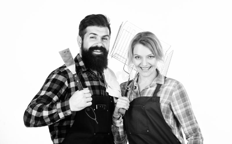 Preparation of food. Man bearded hipster and girl. Preparation and culinary. Couple in love hold kitchen utensils. Tools royalty free stock image
