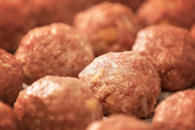 Preparation of fresh raw meatballs for cooking at home royalty free stock photo