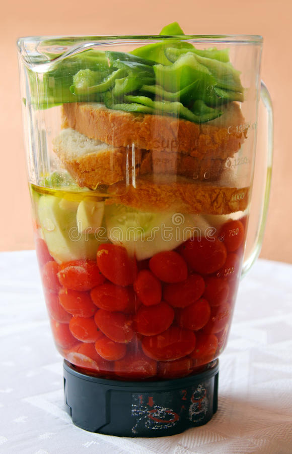 Preparation of gazpacho. Ingredients to prepare Andalusian gazpacho in a blender jar stock photos
