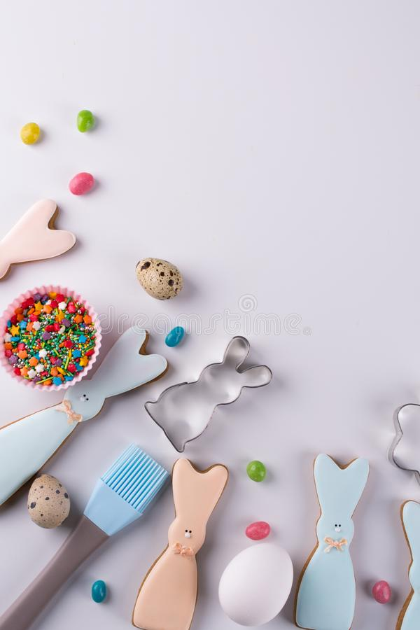 Preparation of gingerbread cookies. Easter cookies in the shape of a funny rabbit , tools necessary to make gingerbread pastry, royalty free stock photo