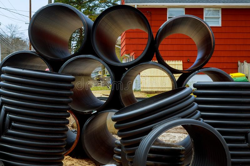 Preparation for installation plastic pipes for the sewage system. Preparation for installation plastic pipes for the stacked black plastic industrial tubes royalty free stock photos