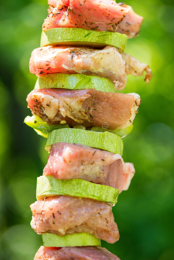 Preparation of meat skewers for barbeque stock photos