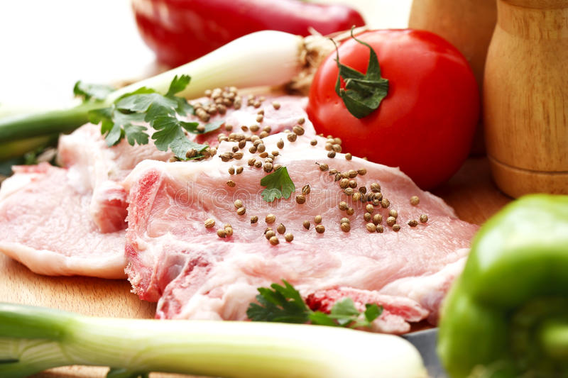 The preparation of meat and vegetables for a meal royalty free stock photography