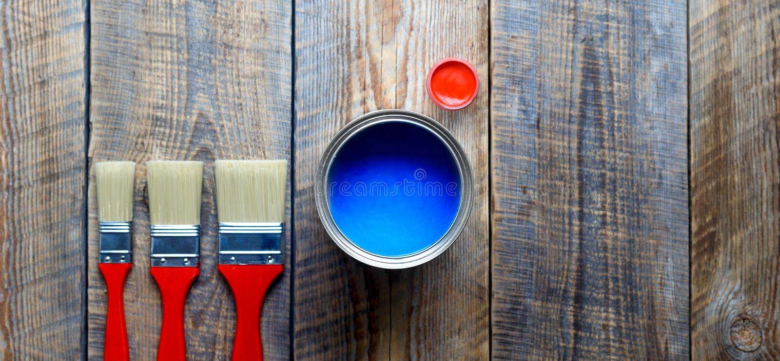 Preparation for painting wooden floor at home with blue paint. Process of preparation for painting wooden floor at home with blue paint top view royalty free stock images