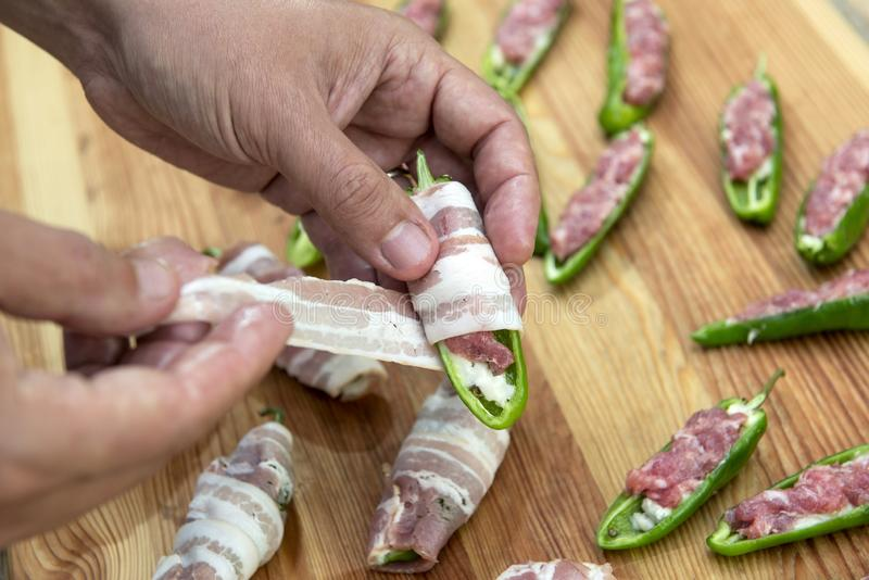 Preparation of peppers stuffed with cheese and minced meat and c royalty free stock photos