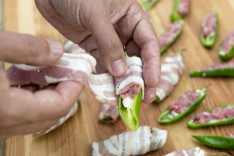 Preparation of peppers stuffed with cheese and minced meat and c stock image
