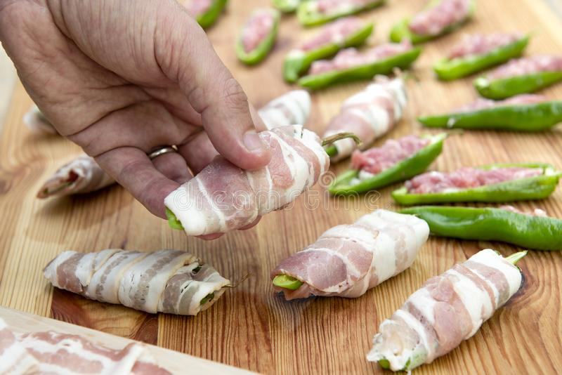Preparation of peppers stuffed with cheese and minced meat and c royalty free stock images