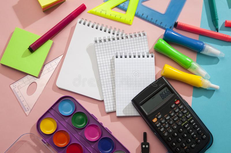 Preparation of primary school children. Bright and multicolored school background with stationery accessories for the study of royalty free stock photography