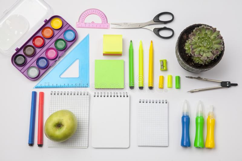Preparation of primary school children. Bright and multicolored school background with stationery accessories for the study of stock image
