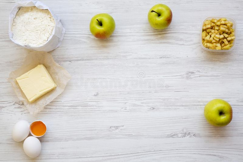 Preparation recipe apple pie or strudel ingredients on white wooden background, top view. Flat lay. royalty free stock photos