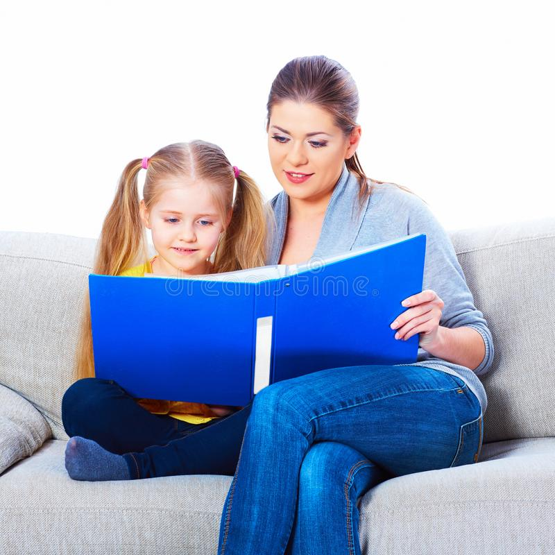 Preparation for shcool little gir. L with mother at home stock photography