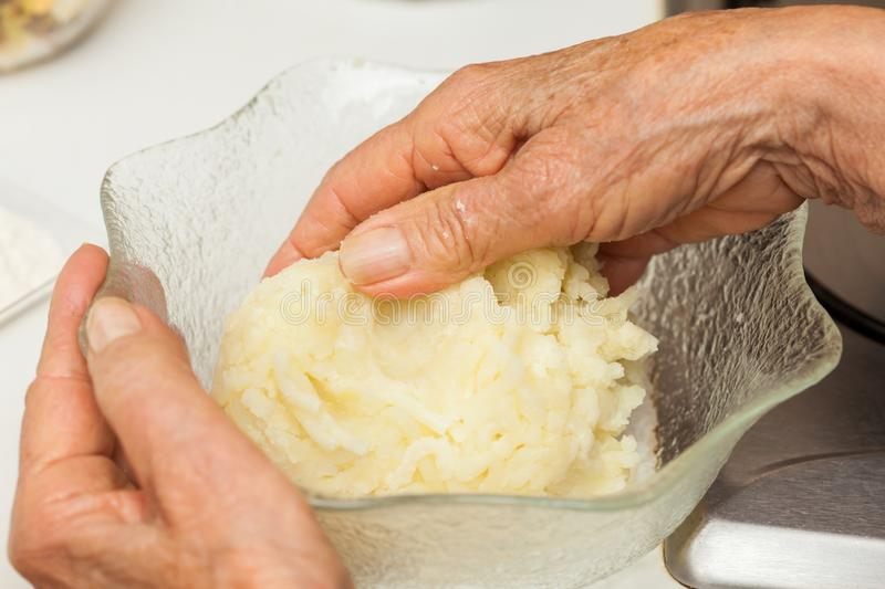 Preparation steps of traditional Colombian dish called stuffed potatoes stock photography