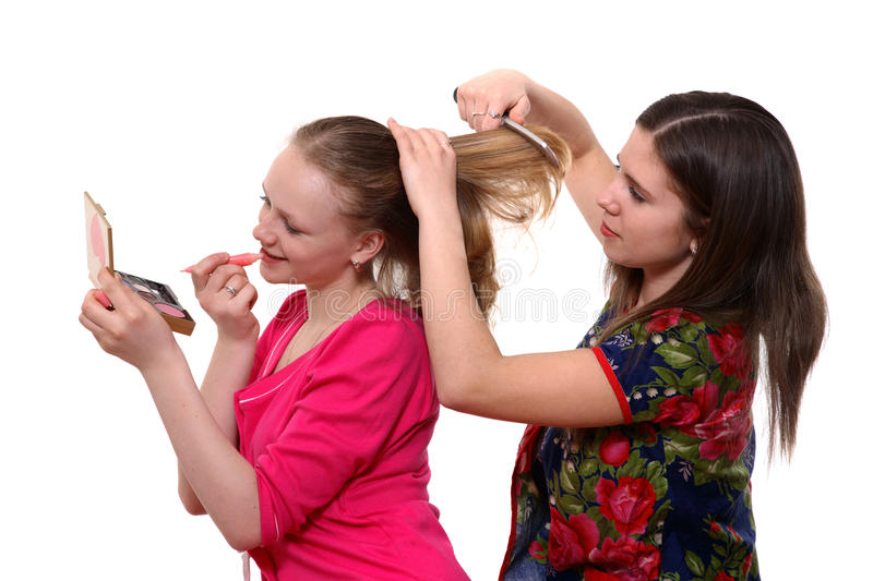 Preparation to evening party. Two young girls having fun putting make up stock images