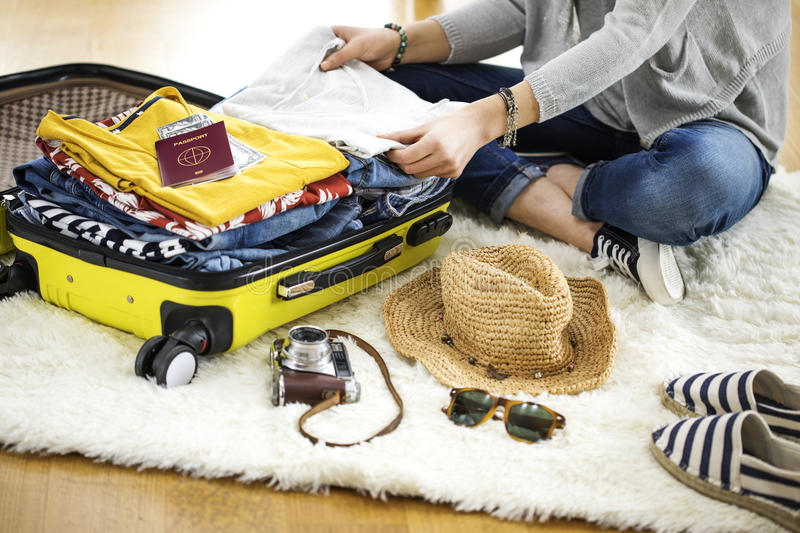 Preparation travel suitcase at home stock image