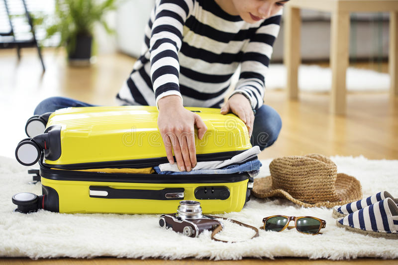 Preparation travel suitcase at home stock images