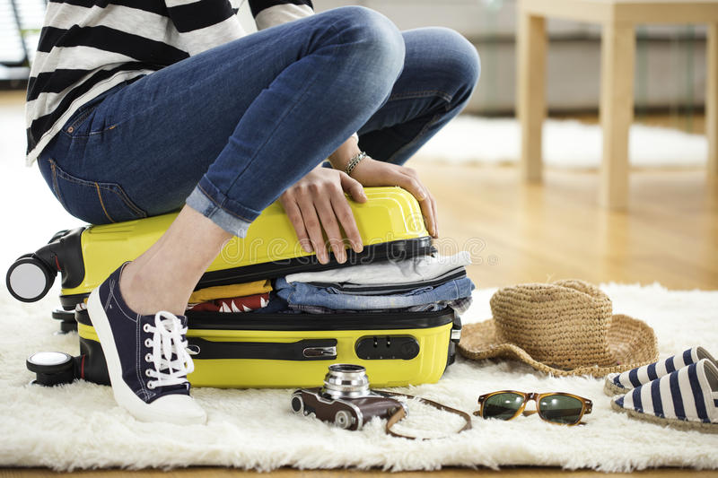 Preparation travel suitcase at home stock photography