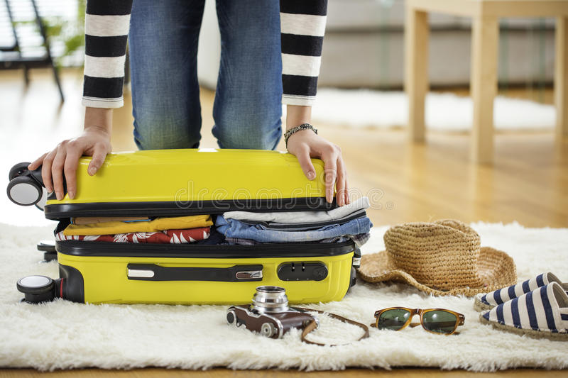 Preparation travel suitcase at home stock photos