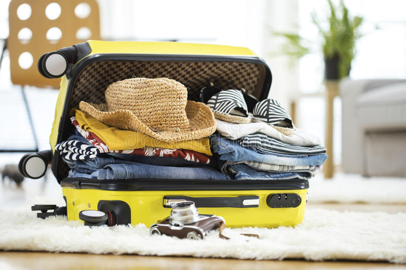 Preparation travel suitcase at home royalty free stock photo