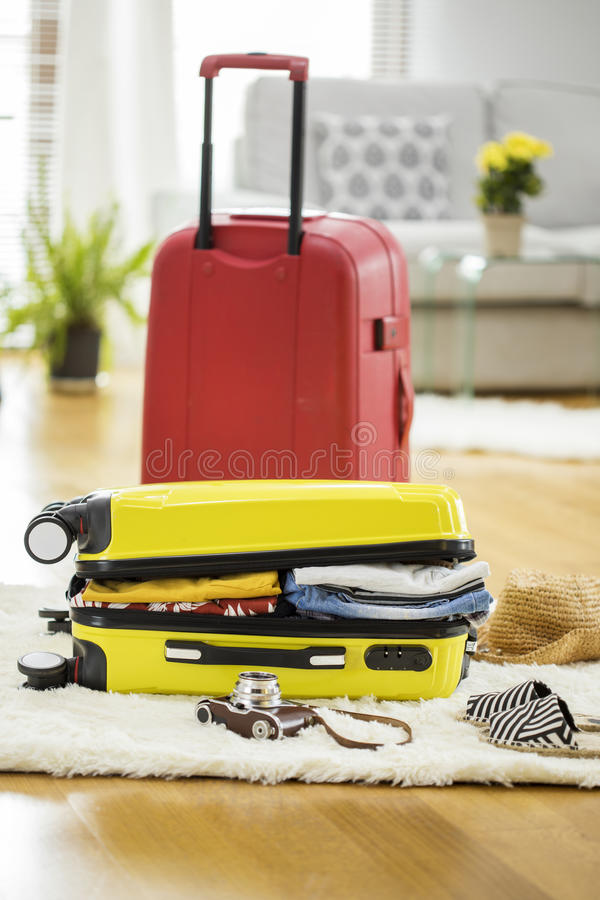 Preparation travel suitcase at home royalty free stock photos
