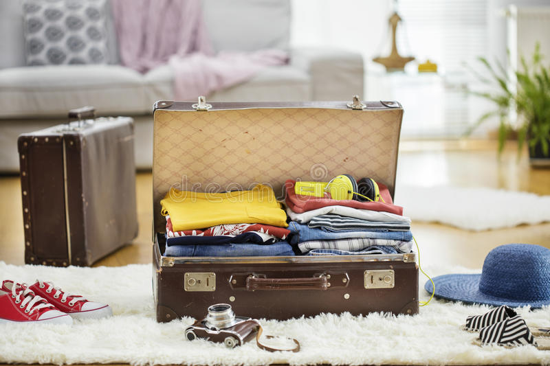 Preparation travel suitcase at home royalty free stock images