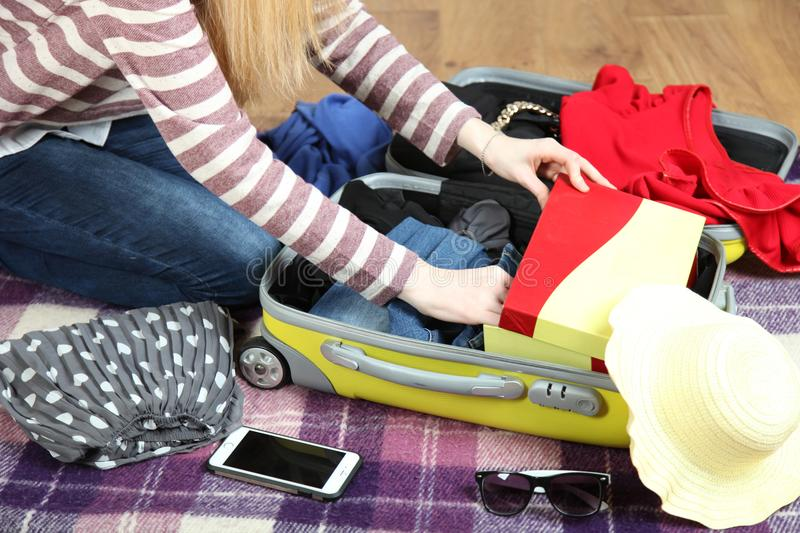 Preparation travel, a suitcase royalty free stock image