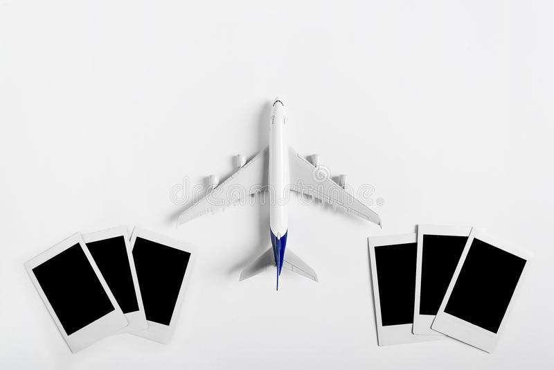 Preparation for Traveling concept, Airplane with blank Photograph. Preparation for Traveling concept, Airplane with blank Photograph, on white background and royalty free stock photography
