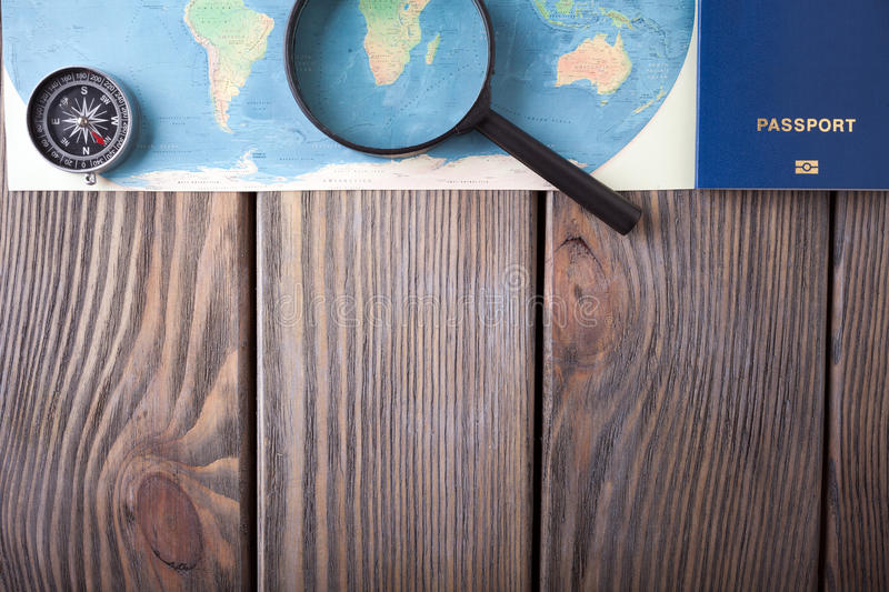Preparation for Traveling concept, passport, compass, map on a wooden background. Preparation for Traveling concept, passport, compass, map on a wooden stock photography